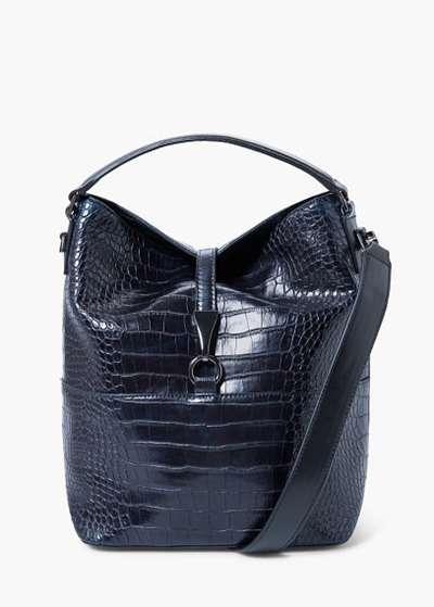 Хіт сезону: взуття і сумки з лакованої шкіри